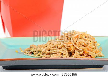 Meat, noodles and red take away container