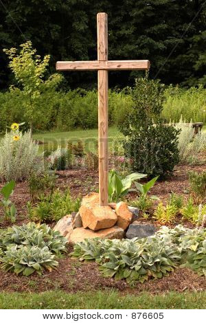 Wooden Cross In Flower Garden