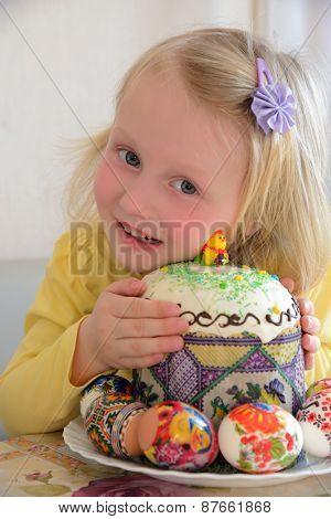 girl holding Easter cake