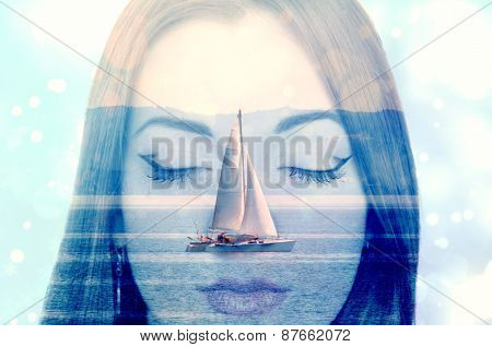 Double exposure of a young woman dreaming about sailing on the sea