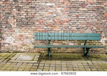 Green Bench Brick Wall