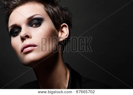 Fashion brunette woman with short hair cut