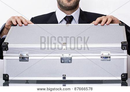 Man opens suitcase