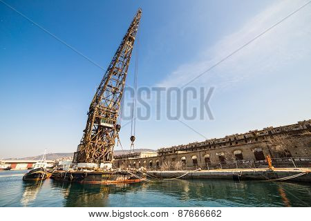 An Old Crane In The Port Of Trieste