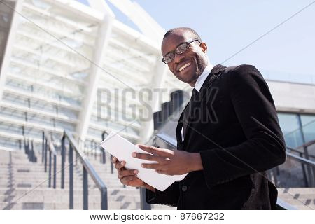 Happy Black Businessman Documents Handling