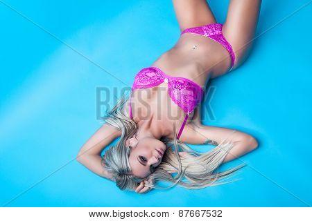 Attractive Blonde Girl On Floor
