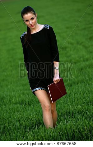 Business woman with an agenda in the park