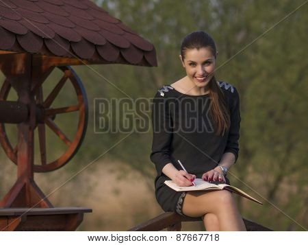 Young girl studying in a park