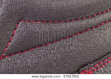 Close up of red stitch.