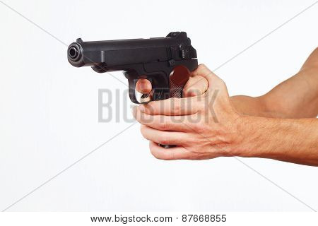 Hands with semi-automatic gun on white background