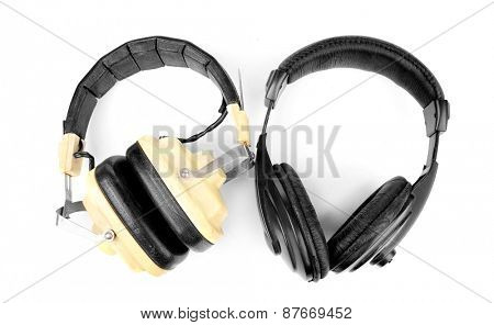 Old headphones isolated on white