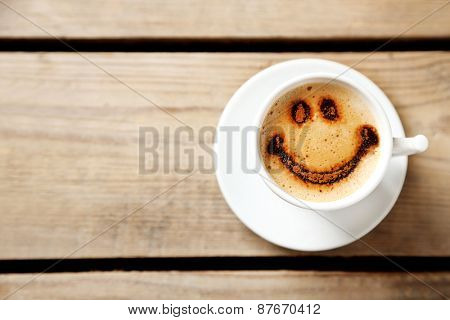 Cup of coffee on old wooden table
