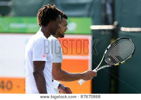 KEY BISCAYNE, FL-MAR 26: Jo-Wilfried Tsonga (R) and Gael Monfils of France during men's doubles on day four of the Miami Open at Crandon Park Tennis Center on March 26, 2015 in Key Biscayne, Florida.