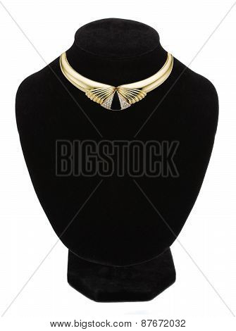 Beautiful Golden Necklace On Black Mannequin Isolated On White