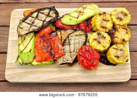 Grilled Vegetables On The Wood Background