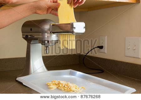 Chef Preparing Homemade Fettuccine Pasta