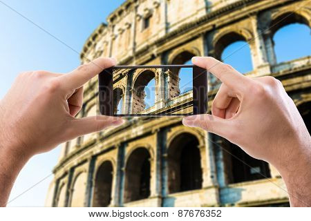 Hand holding Smartphone in Rome, Italy
