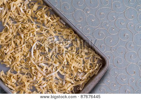 Homemade Fettuccine Pasta Drying On A Metal Tray