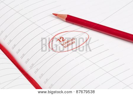 Red Pencil And Notebook