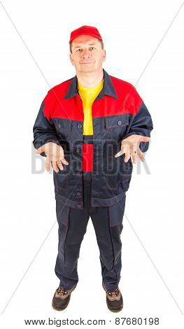 Worker in workwear and red cap.