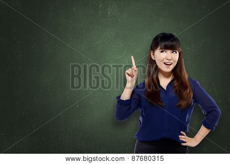 Pretty Asian Woman Pointing Empty Space