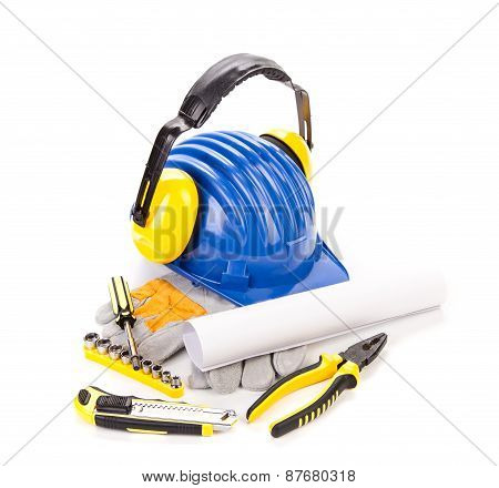 Hard hat with tools for architects.