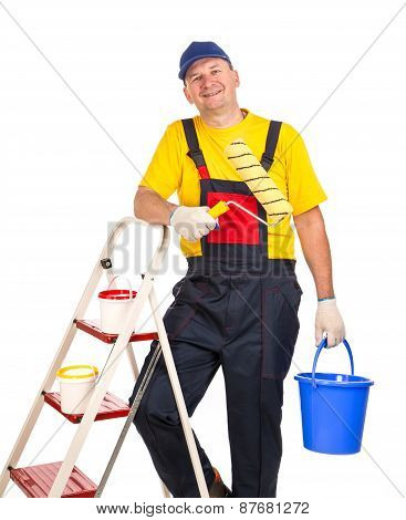 Worker on ladder with roller.