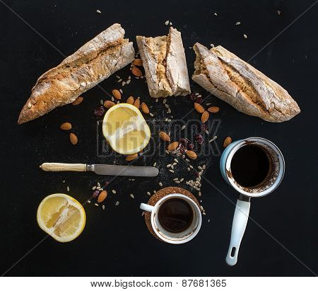 Rustic Breakfast Set Of French Baguette Broken Into Pieces, Grapefruit, Sunflower Seeds, Almonds And