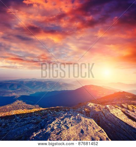 Great view of the hills by sunlight of red. Dramatic unusual scene. National park Chornogora. Carpathian, Ukraine, Europe. Beauty world. Retro style, vintage soft filter. Instagram toning effect.