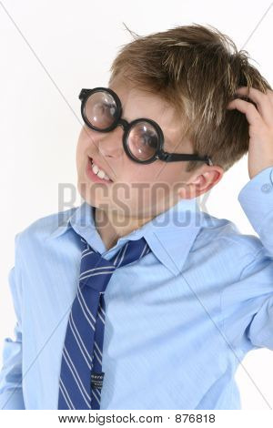 School Student In Comical Spectacles And A Confusedl Expression