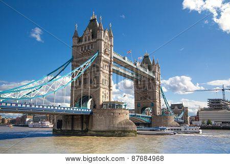 LONDON, UK - AUGUST 16, 2014: Tower bridge and river Thames South bank walk.