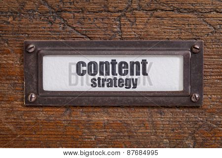 content strategy  - file cabinet label, bronze holder against grunge and scratched wood