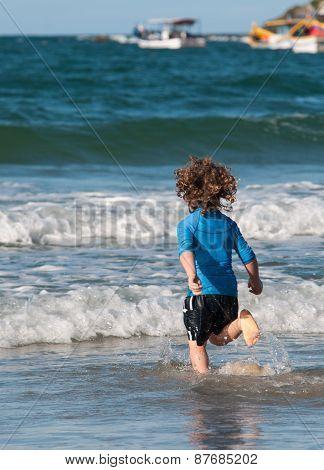 Caucasian boy running