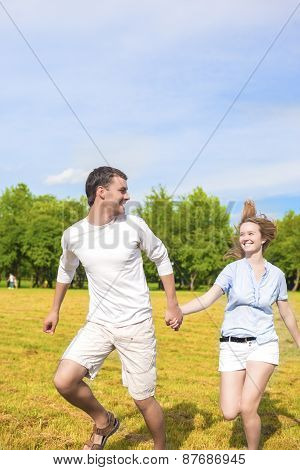 Youth Lifestyle Concept: Beautiful Caucasian Couple Having Their Outdoor Holiday Together.