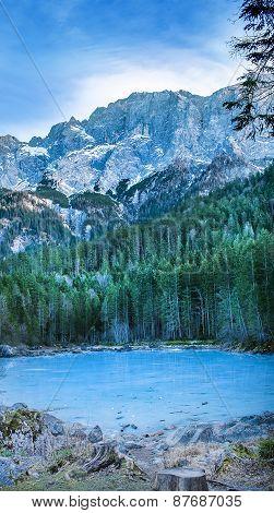 Frozen Forest Lake In Bavarian Alps Near Eibsee Lake