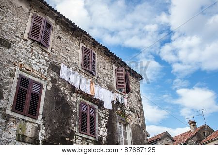 Common House Of The Old Town Of Kotor, Montenegro, With Linen Ha