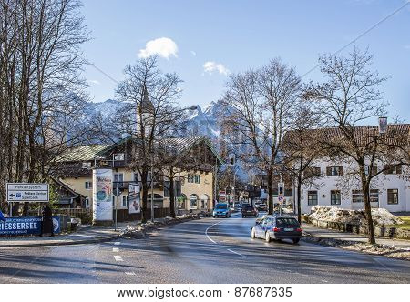 Small Alpine Town Street With Traffic And Typical Houses