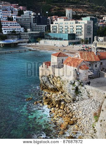 View over the old town buildings on a cliff beach and hotel