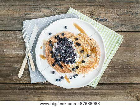 Dutch Waffles With Cream-cheese, Fresh Blueberry And Maple Syrup On A White Ceramic Plate Over A Rou