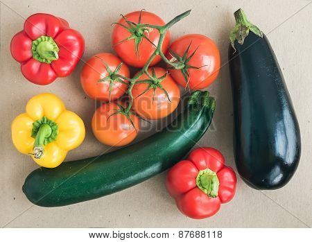 Vegetable Set: Ripe Tomatoes, Paprika, Zuccini And An Aggplant On Craft Paper