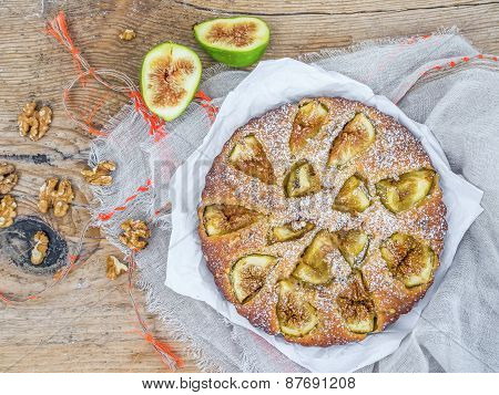 Fig Cake With Fresh Figs And Walnuts Over A Rough Wood Surface