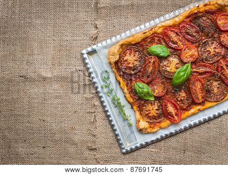 Rustic Tomato Autumn Pie On A Silver Tray Over A Sackcloth Surface