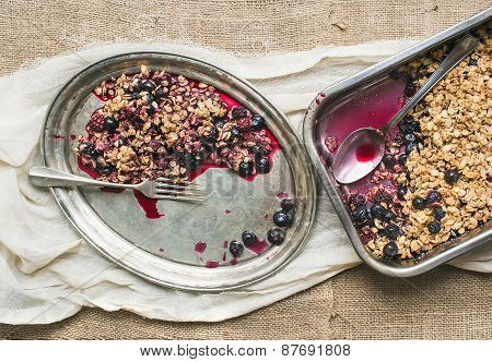 Oat Granola With Fresh Berries On A Silver Dish With A Fork On A Sackcloth Surface