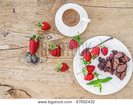 A Piece Of Chocolate Strawberry Cake With Fresh Strawberries