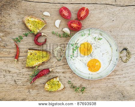 Breakfast Set With Roasted Eggs, Bread Toasts With Pesto Souce, Cherry-tomatoes And Spices
