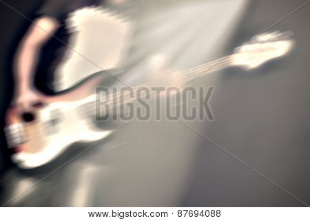 Guitarist On Stage In A Spotlight
