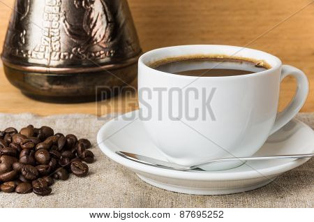 Scattered Coffee Beans, Turk And Glass Cup