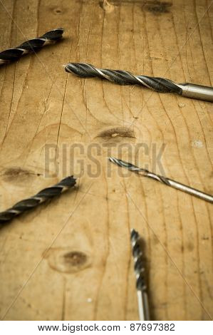 Drill Bits On Wooden Table