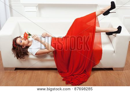 Girl With Rose On A Sofa.