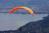 stock photo of annecy  - tandem paraglider flying above Lake Annecy - JPG